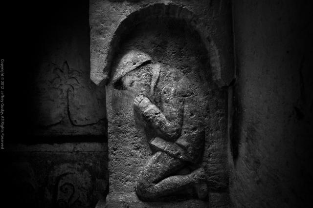 Praying French soldier