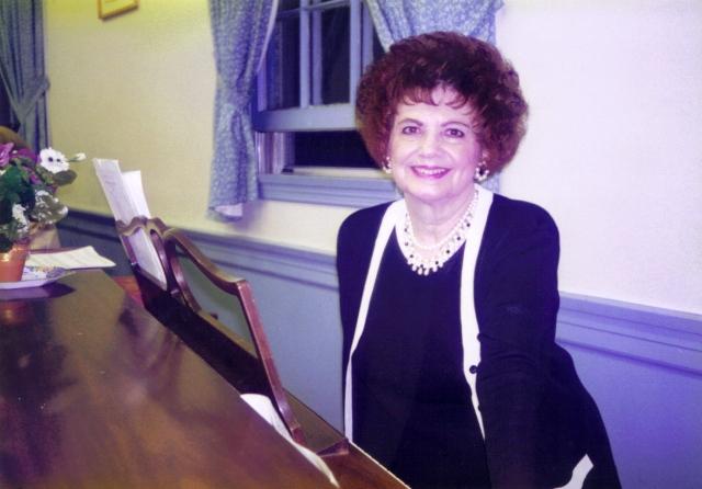 Joan Hartz at the piano